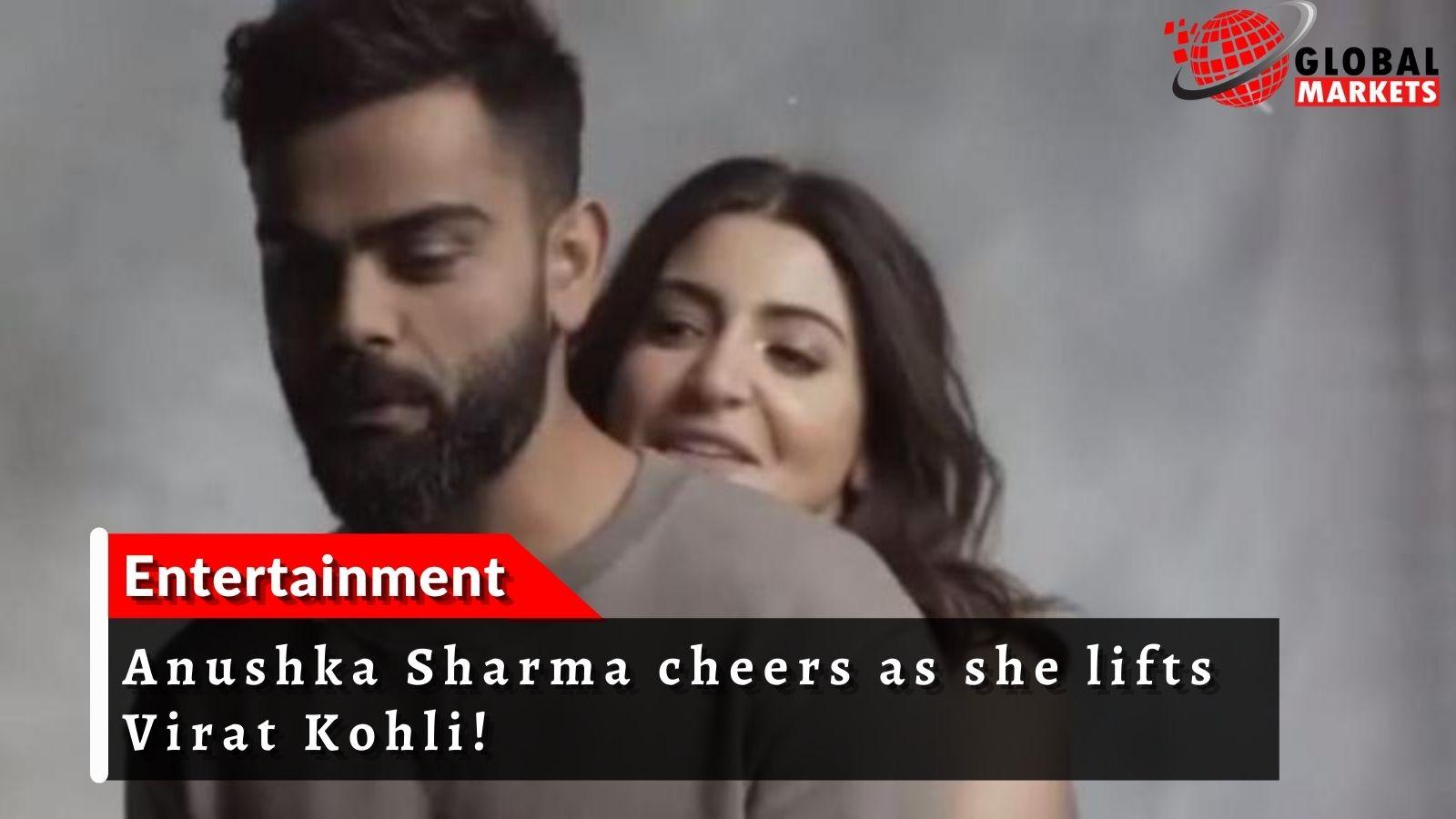 Anushka Sharma cheers as she lifts Virat Kohli!